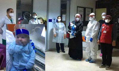 Koronavirüsü yenen 17 günlük bebek ile anne ve babası alkışlarla taburcu edildi