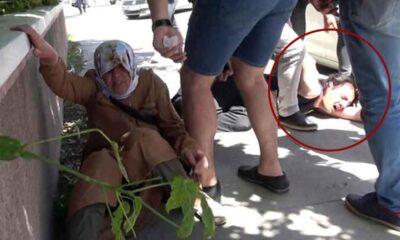 Cadde ortasında annesini tekmeleyen erkek, çevredekiler tarafından dövüldü