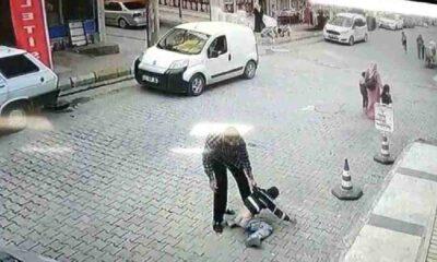 Küçük çocuğu sokak ortasında yere vurarak döven adam tutuklandı