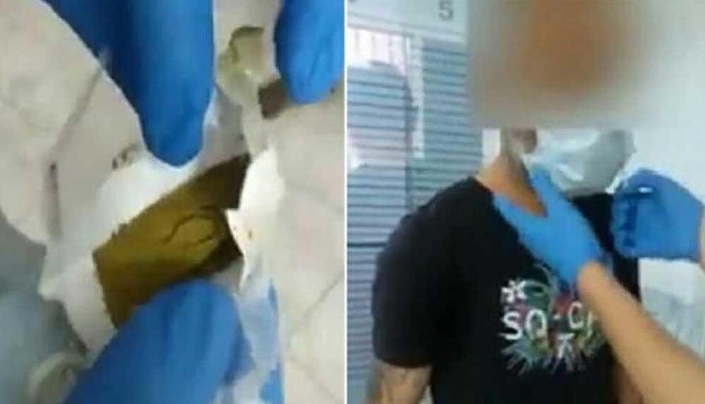 Şüphe üzerine durululan adamın taktığı maskeden esrar çıktı