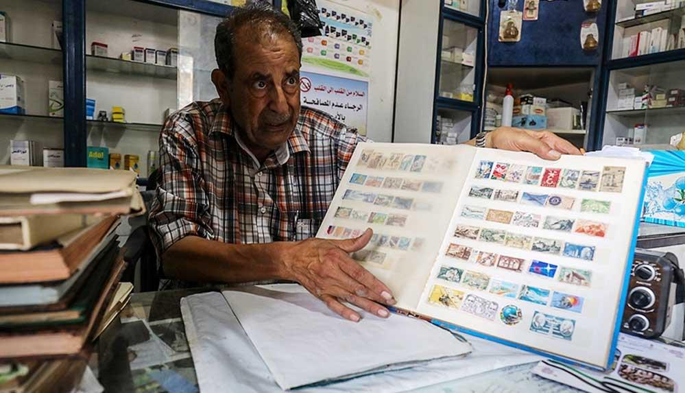 Filistinli pul koleksiyoneri eczacı, 60 yılda topladığı 10 bini aşkın pula gözü gibi bakıyor