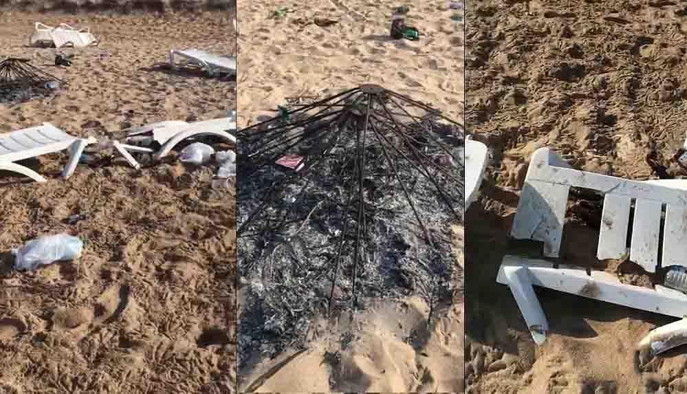 Tatilciler, Bozcaada sahilindeki partide şezlongları kırıp şemsiye yaktılar